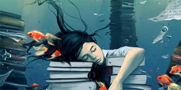 девушка уснула на книгах